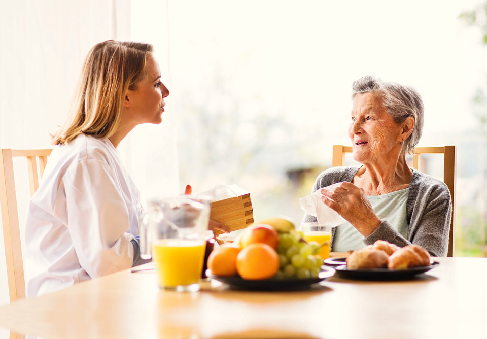 senior woman talking with her caregiver