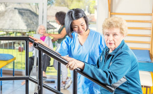 caregiver assisting a senior woman