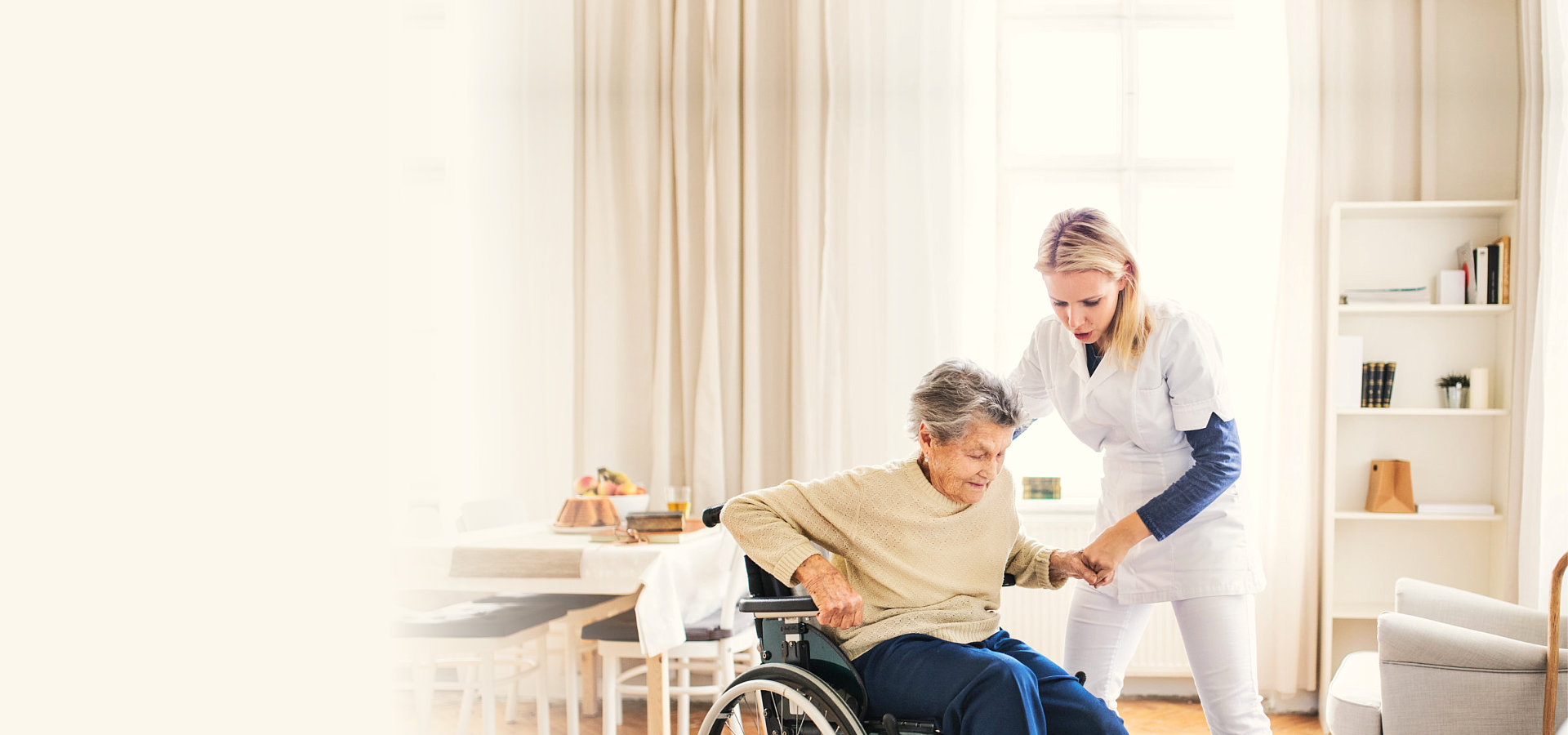 nurse assisting a senior woman